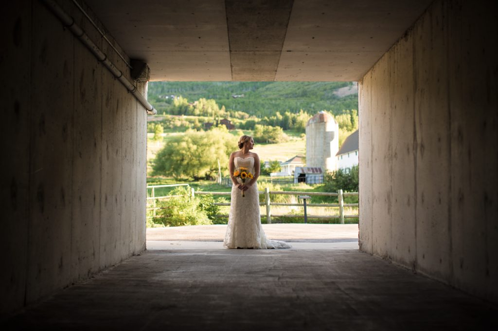 Backlit bridal photography in a tunnel.